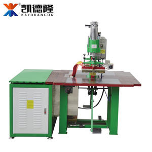 China raincoat making machine price