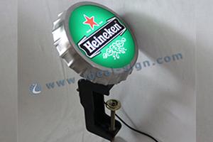 Heineken metal cap opener