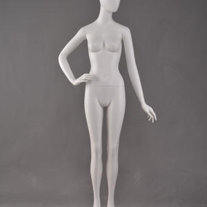 egg head female german mannequin on stand