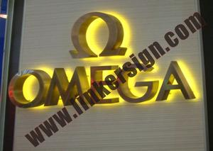 yellow lighted stainless steel build up letter signage