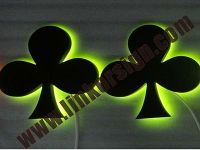 yellow lighted stainless steel build up logo signage