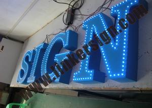 blue led beads lighted shop front signage