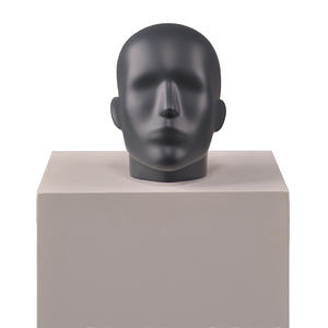High glossy black male head mannequin for window display.