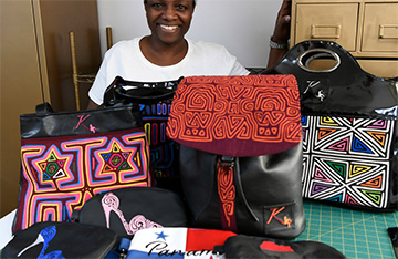 Albany designer carving area of interest with unique fashion luggage