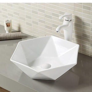 Diamond shape lavatory wash basin