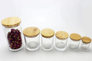 wholesale glass candle candy jar with wooden lids in storage bottle  supplier