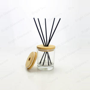 reed diffuser glass bottle with wooden lid with hole and black sticks