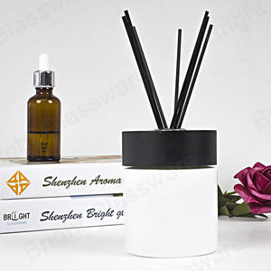 room aroma essential oil glass white reed diffuser bottle with black screw cap and fiber stick