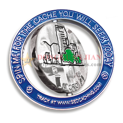 Two-tone plating spinning badges